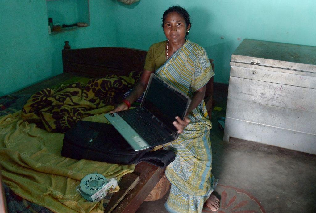 Silworm farmer Munia mumu shows her laptop