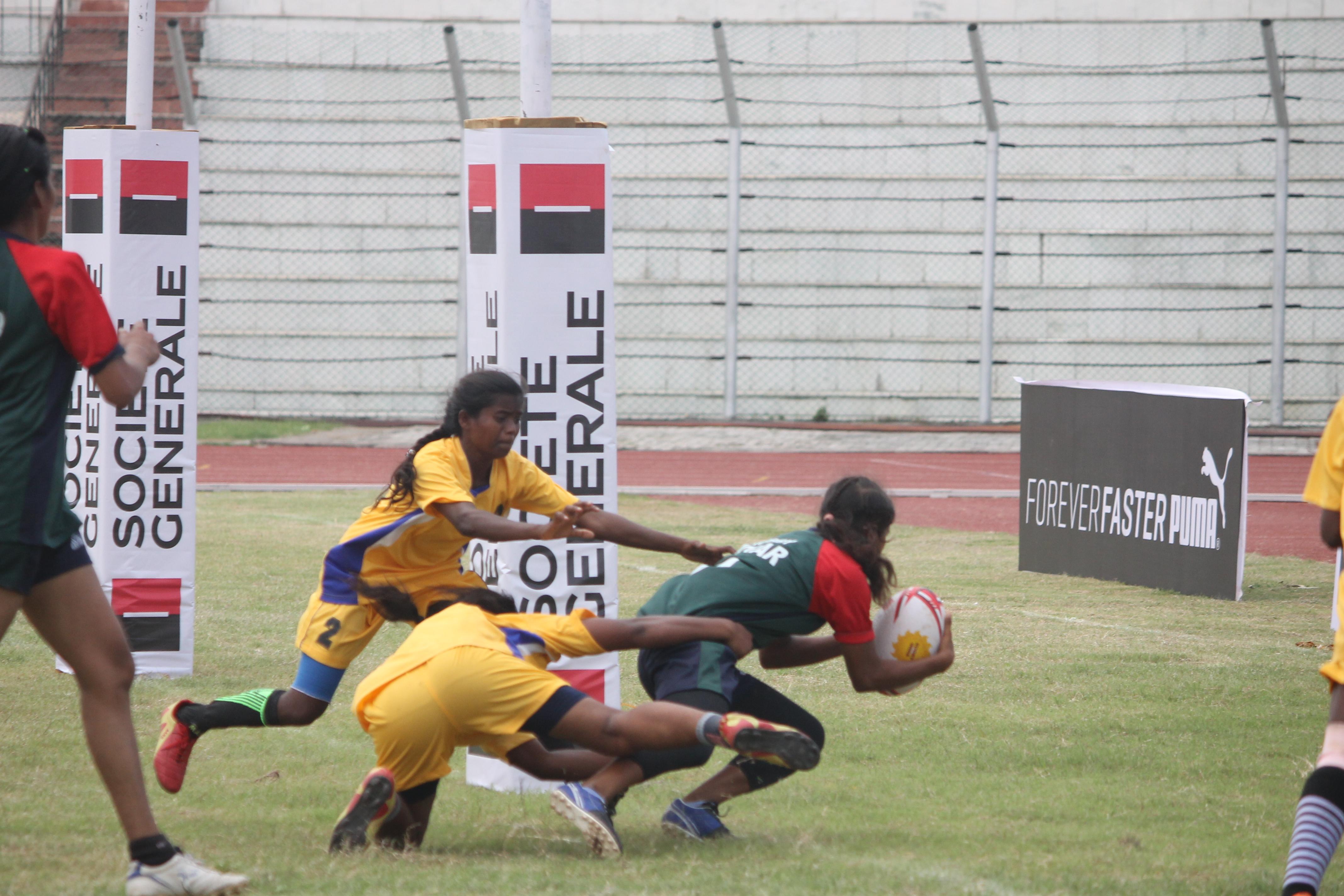 Bihar Womens team in action against Jharkhand , Bihar winning the fixture 27-0