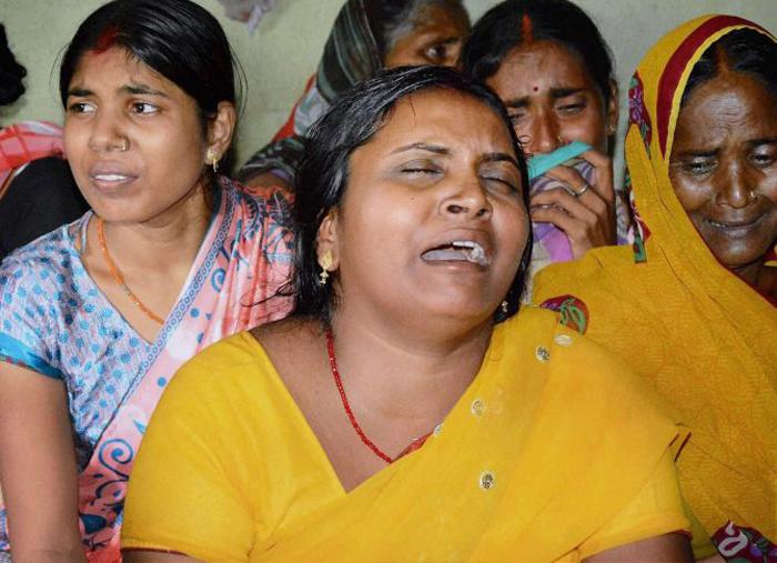 Gaya : Wife of army soldier Sunil Kumar vidyarthi who was killed in Uri Army base attack, mourns her husband's death in Gaya on Monday. PTI Photo (PTI9_19_2016_000113B)
