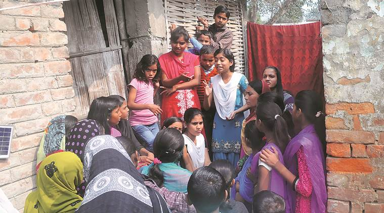 Afreen and Shadia (in red) engage women in Newra village, Muzaffarpur. (Source: Express photo by Prashant Ravi)